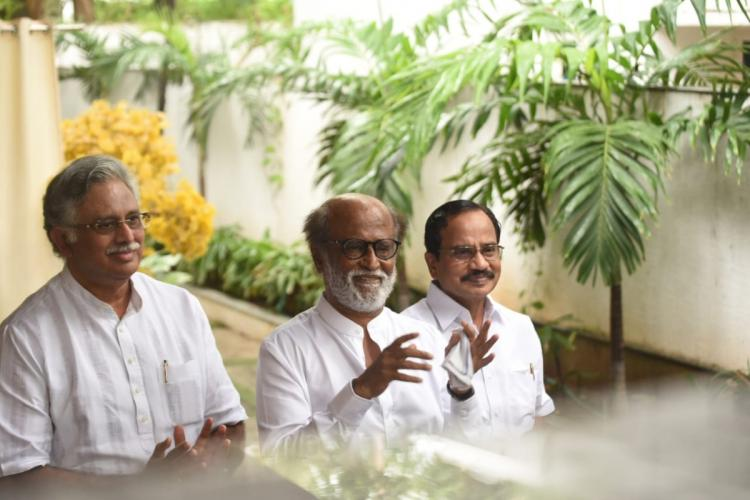 Actor-turned-politician Rajinikanth along with the functionaries of his proposed party Tamilaruvi Manian and Ra Arjunamurthy