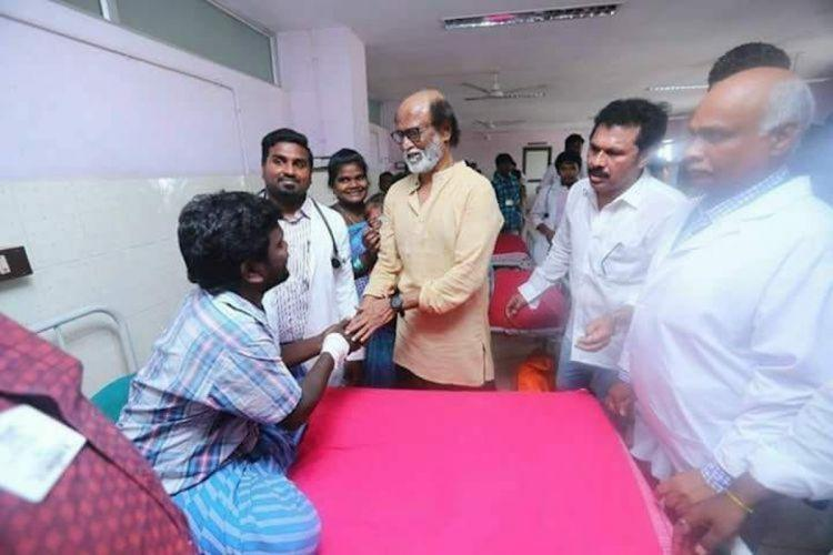 Actor Rajinikanth interacting with those injured in the police firing during the anti-Sterlite protest in 2018 He interacted with them at the hospital along with other leaders He is seen holding the hand of an injured person