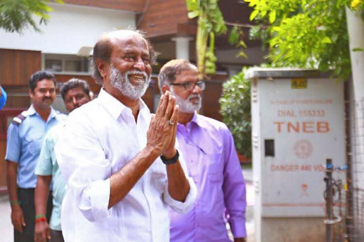 Actor turned politician Rajinikanth with folded hands in front of his residence
