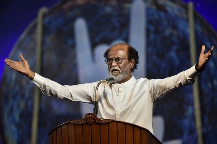 Actor turned politician Rajinikanth addressing fans and RMM members with his hands outstretched