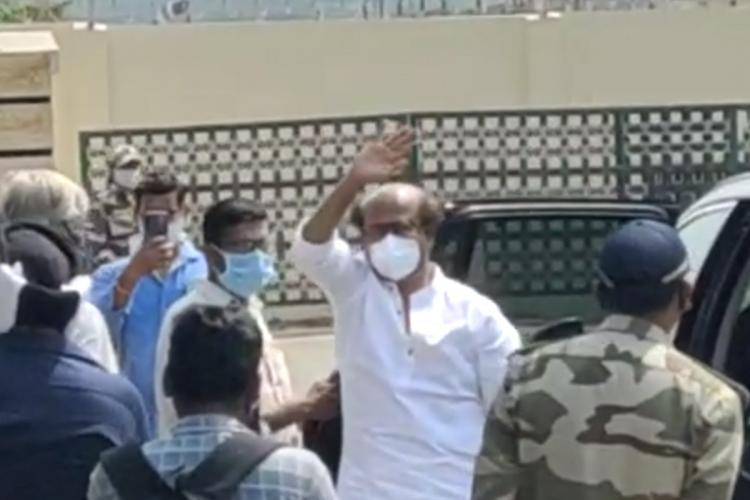 Rajini is seen waving at fans cheering for him while leaving to Hyderabad for shoot
