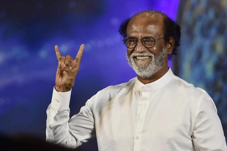 Rajinikanth makes baba sign and smiles