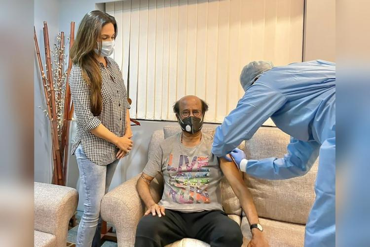 A medical professional is seen administering the vaccine to superstar Rajinikanth