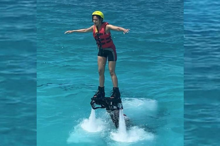 Rakul Preet on a Flyboard with her arms spread wide