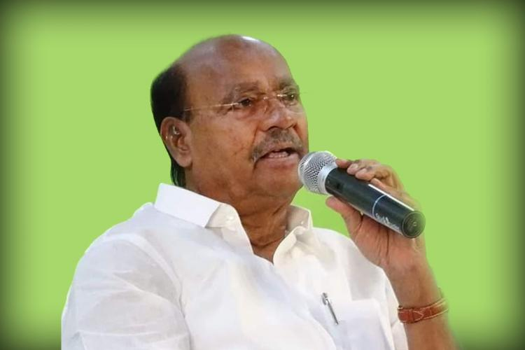 PMK founder Ramadoss holding a mic and addressing a gathering