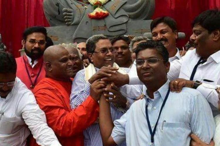 Shake hands and bury past differences Ktaka CM attempts to unite feuding Jarkiholi brothers