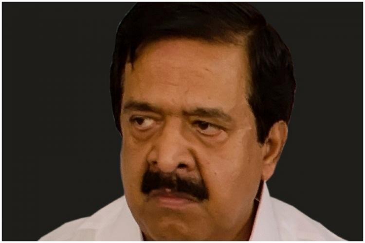 Ramesh Chennithala looks to the side against a black background