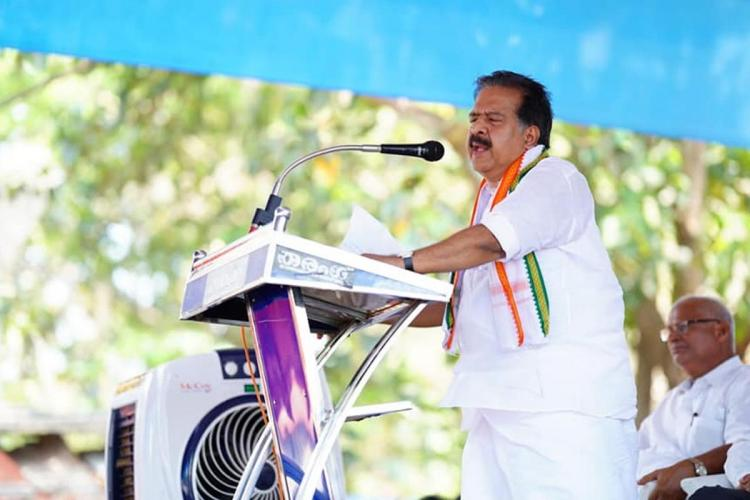 Kerala opposition leader Ramesh Chennithala in front of a mike speaking at a meeting
