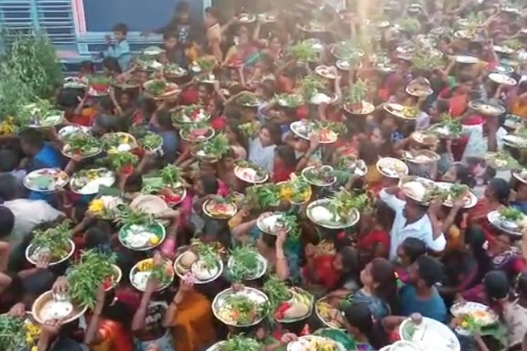 Watch Residents in Karnataka village hold temple fair to ward off coronavirus