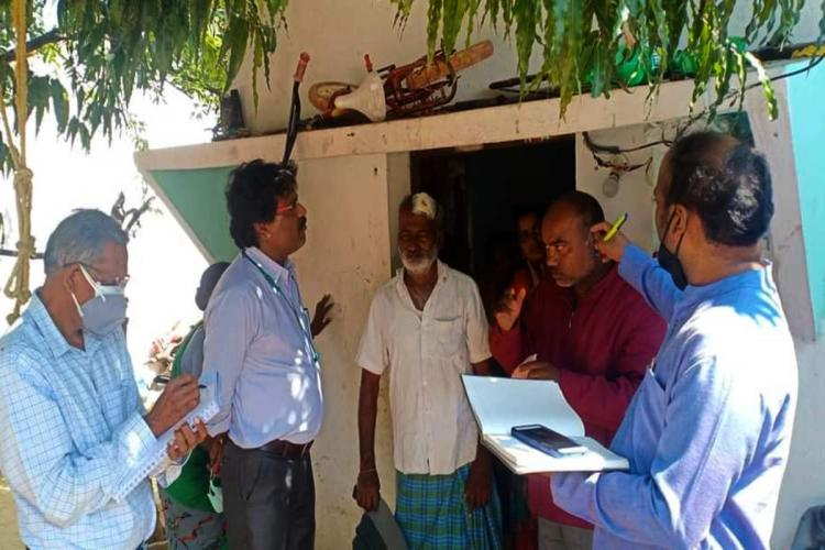 Members of fact finding team from Voice of Dalit Collective interact with the victims in the Ramojipeta of Sircilla