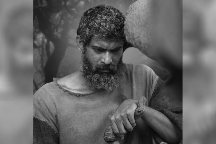Rana Daggubati essays the role of an elderly person and looks dejected in a still from 'Aranya'.