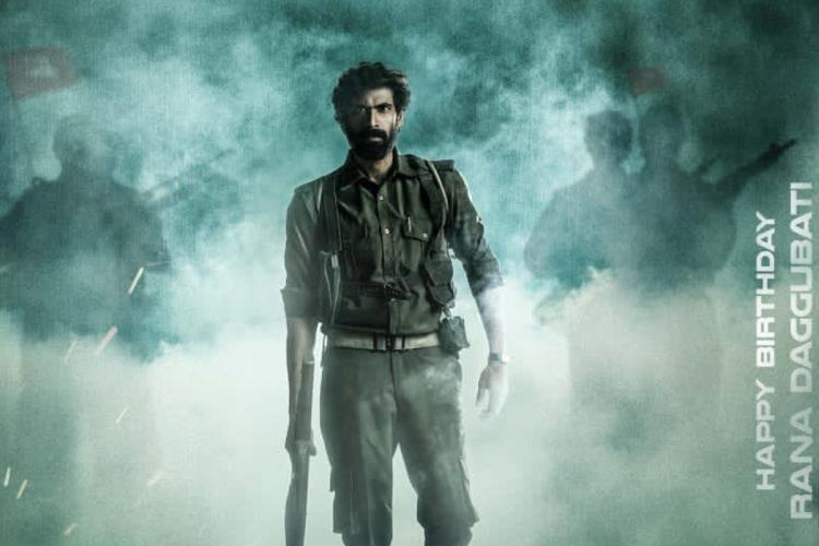 Virata Parvam poster in which actor Rana was seen wearing a khaki coloured dress in an smokey background