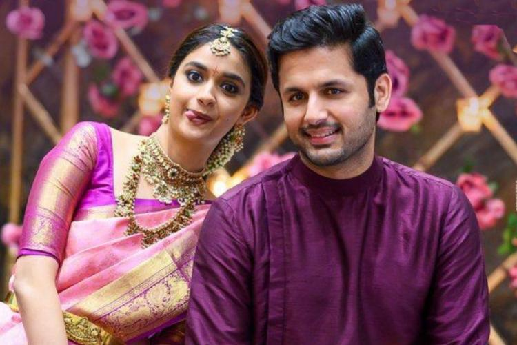 Keerthy Suresh is seen donning a pink bridal saree while Nithiin is seen in a purple Kurta in the image