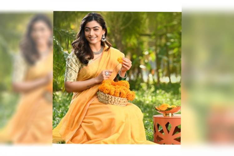 Rashmika Mandanna seen in a pale orange saree stringing marigold in the first-look poster