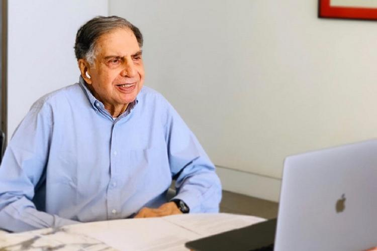 Ratan Tata in front of an Apple laptop