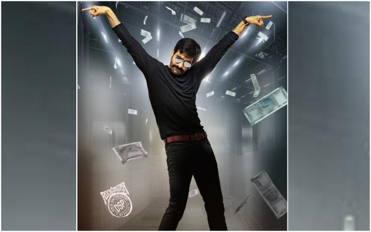 Ravi Teja in Khiladi movie poster seen wearing black dress and flying currency notes in the background