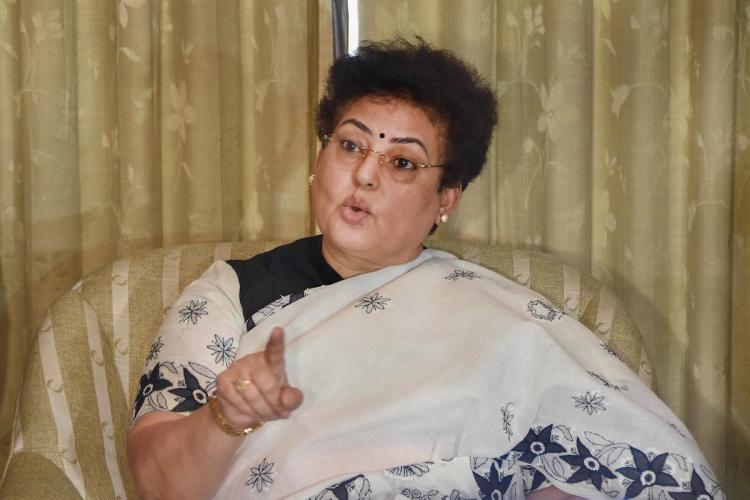 National Commission for Women Chairperson Rekha Sharma wearing a black and white saree seen pointing while addressing the media in Mumbai