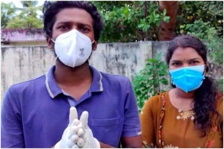 Kerala Covid-19 volunteers Rekha and Aswin Aswin in blue t shirt and Rekha in yellow kurta both wearing mask
