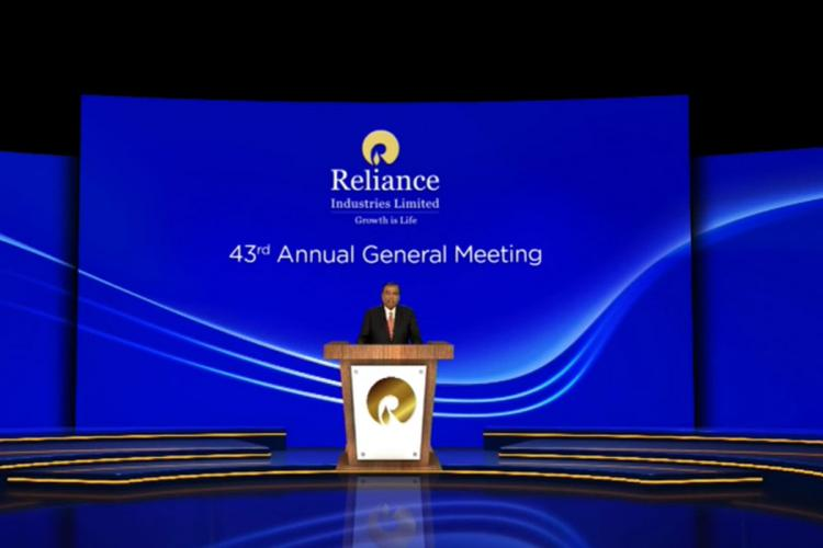 Reliance Industries Chairman Mukesh Ambani wearing black suit addressing AGM