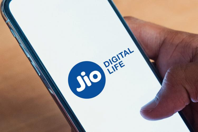 A phone open with Reliance Jio logo