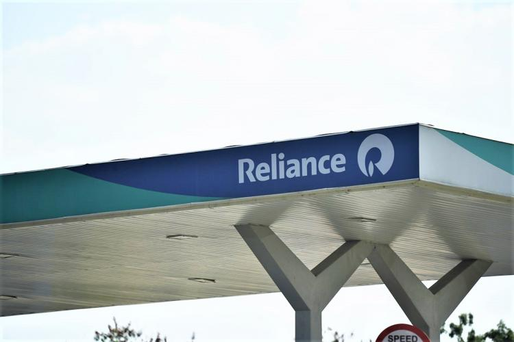 A logo of reliance at a Reliance petrol bunk