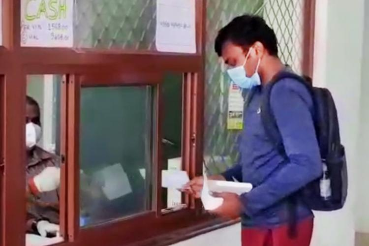 A person purchasing remdesivir vials at a counter