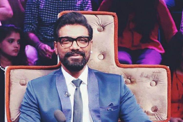 Remo DSouza judge on Dance India Dance in a blue coat and spectacles