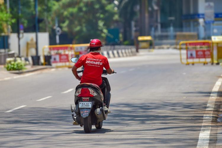 A Zomato delivery executive on a two-wheeler amid the lockdown