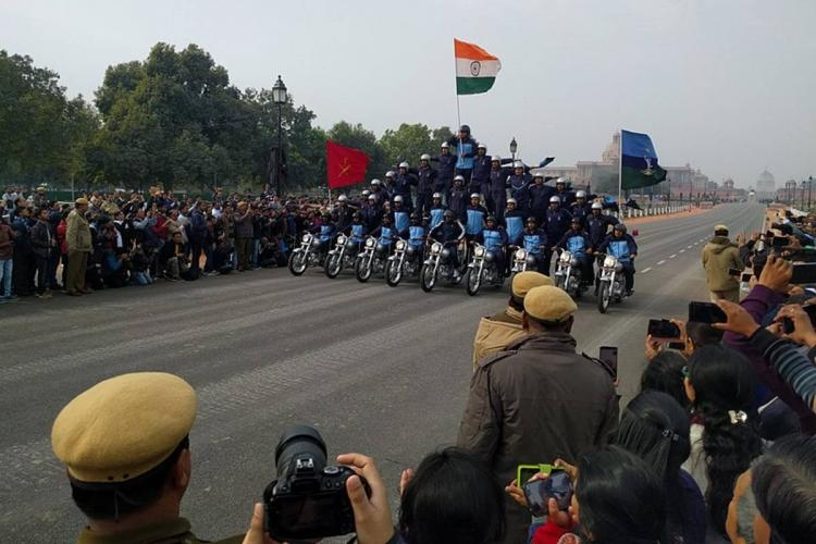 2019 Republic Day parade preparations in Delhi with BSF personnel on bikes with Indian flag hoisted atop a human pyramid on bikes