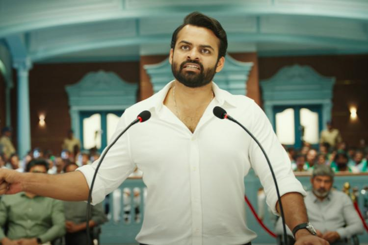 Sai Dharam Tej is seen in a white shirt standing at the podium and giving a speech in the teaser of Republic
