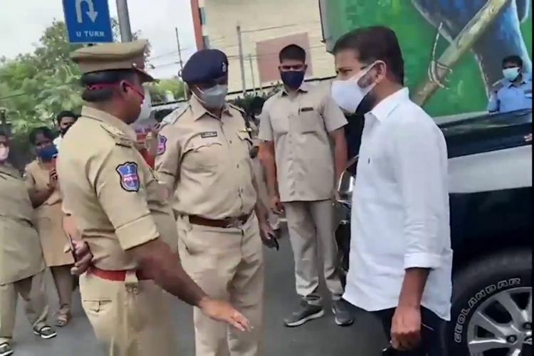 Revanth Reddy talking to police officers in Begumpet