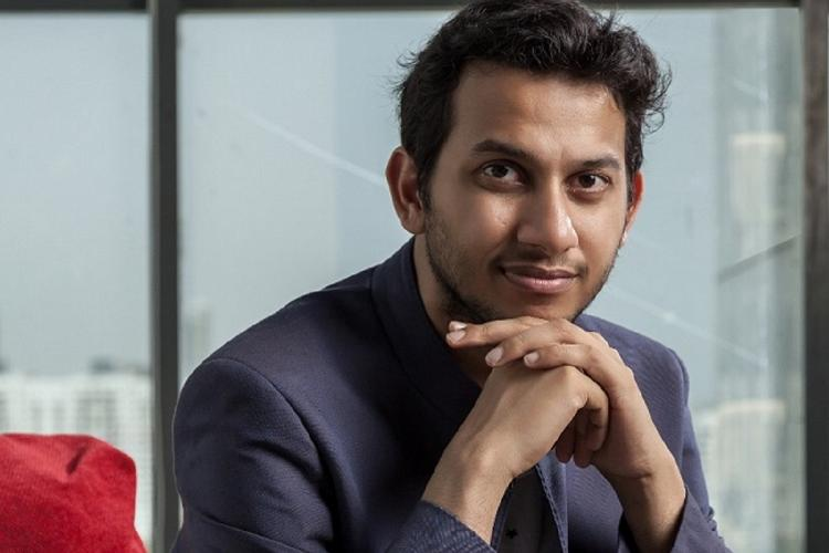 Ritesh Agarwal with his face resting on its hands
