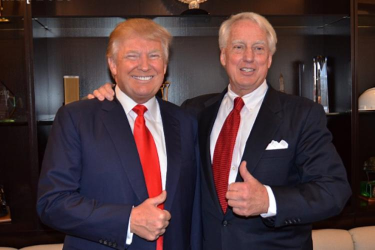 A 2015 photo showing Donald Trump and brother Robert Trump showing a thumbs-up