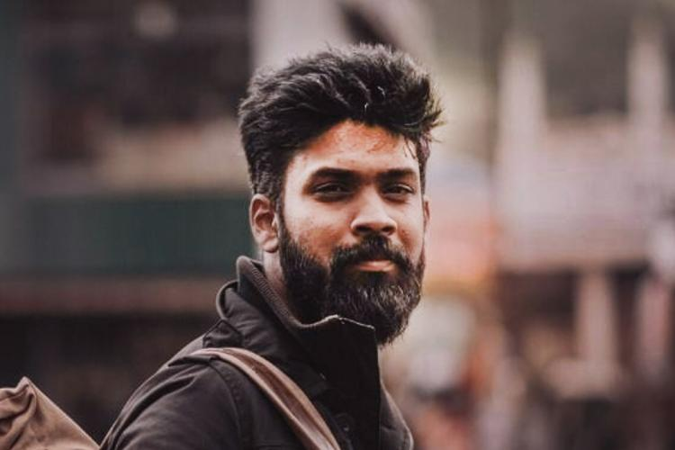 Director Rohith VS with a beard and dressed in black