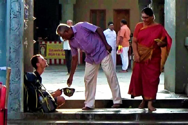 Russian man found begging at Kanchipuram temple cops and Sushma step in to help