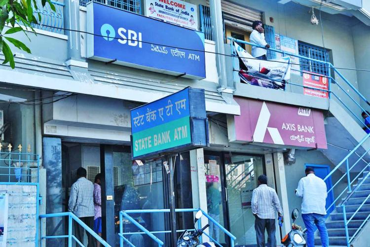 SBI and Axis bank ATMs next to each other