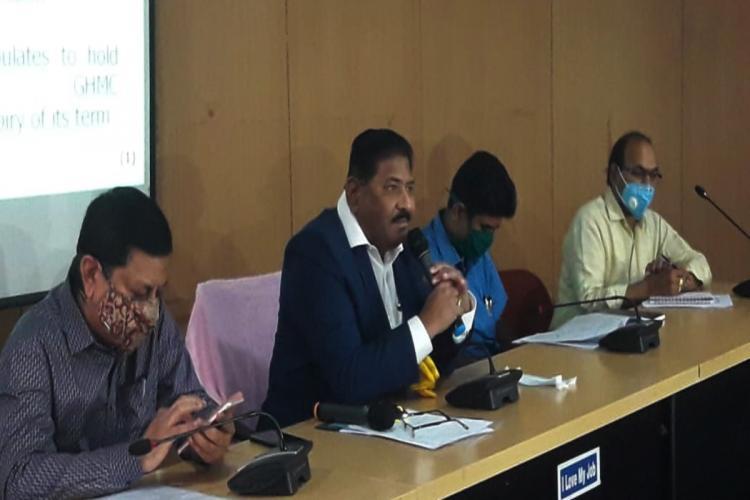 SEC officials announcing GHMC election schedule earlier in Hyderabad
