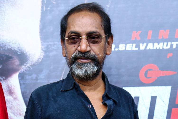 Director SP Jananathan is seen in a blue shirt in an event