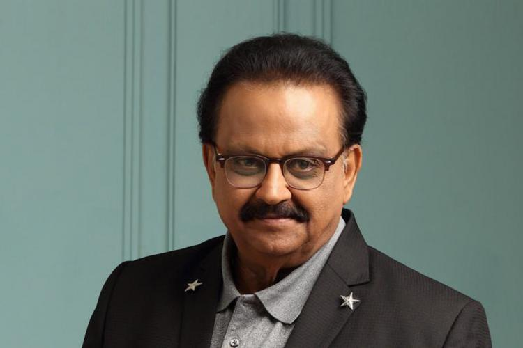 SPB posing for a picture in a suit