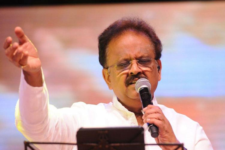 Singer SPB on stage as he performs one of his songs for an audience