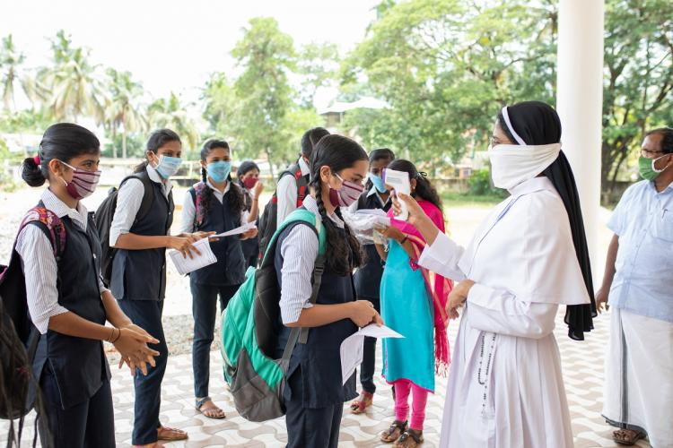 Students being screened at an exam hall in Kerala on the day of SSLC exam