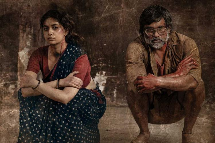 Keerthy Suresh and Selvaraghavan in the Saani Kaayidham movie first look poster The poster shows Keerthy and Selvaraghavan squatting and they look completely tired and defeated On a cloth in front of them are various crude weapons and a bottle It appears as though the two have been nabbed by the police