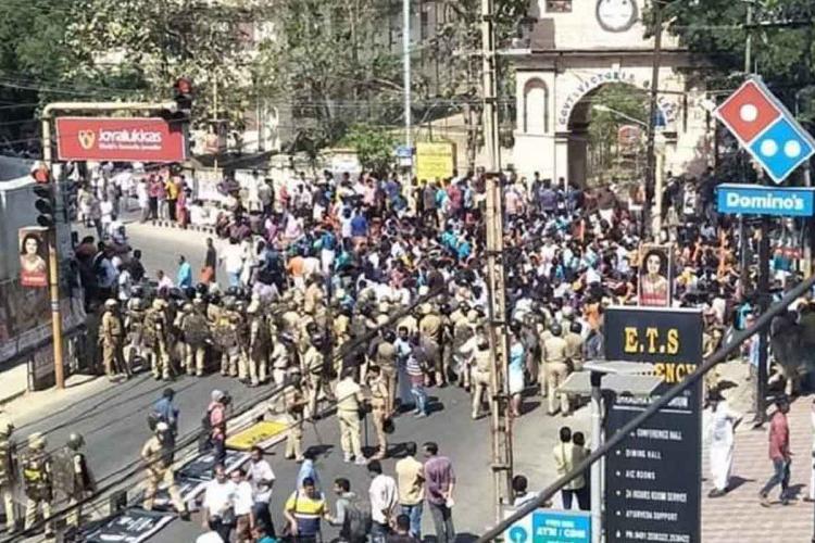Protestors and police clash during the hartal held by Sabarimala Karma Samithi