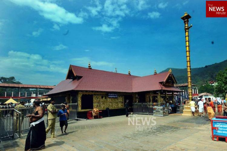 Devotees at the hill shrine Sabarimala temple in Keralas Pathanamthitta district