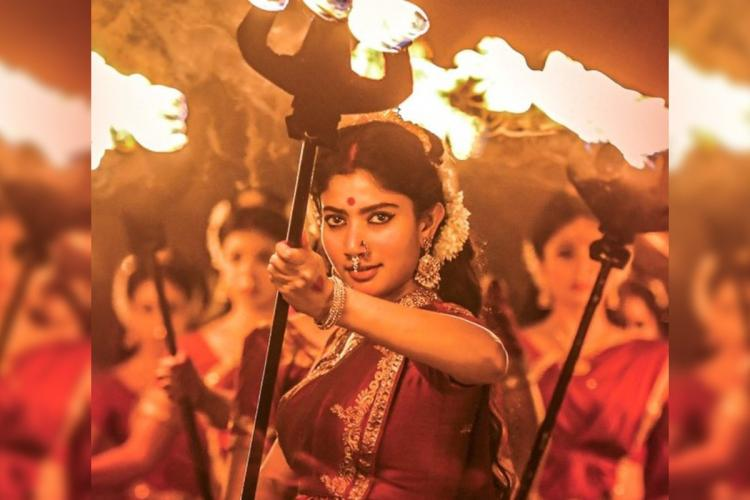 Sai Pallavi holding a fiery trident in poster of Shyam Singha Roy