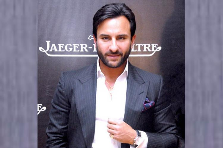 Saif Ali Khan posed for a picture with his watch and a grey coat and a white shirt