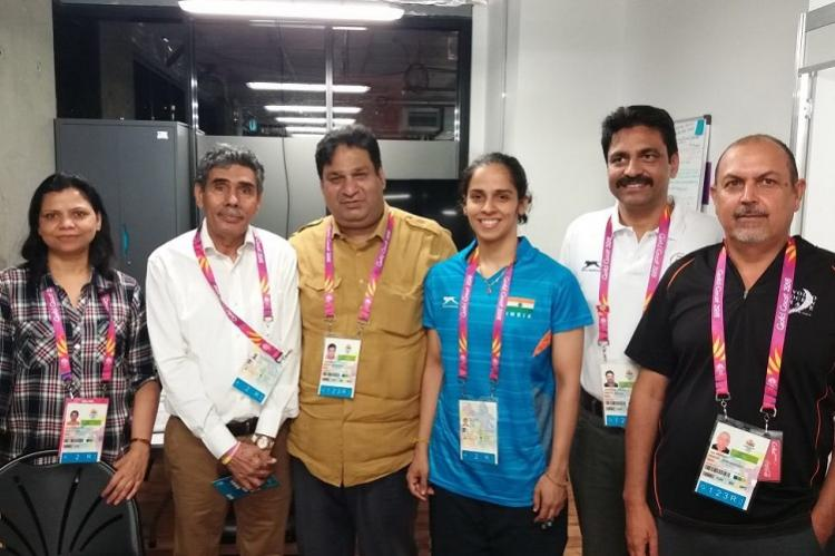 After Saina threatens to pull out of CWG IOA clears accreditation for her father