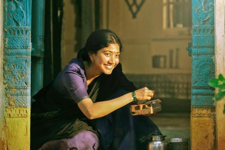 Sai Pallavi looks festive in a black and lavender half saree