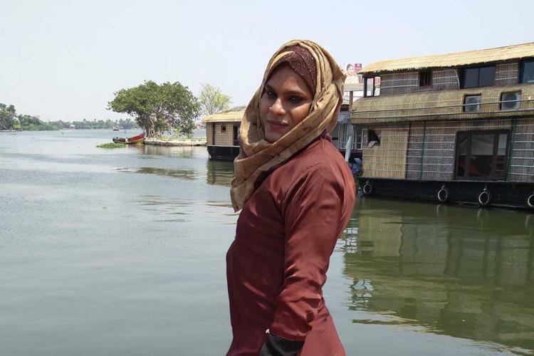 Sajana Shaji standing near backwaters