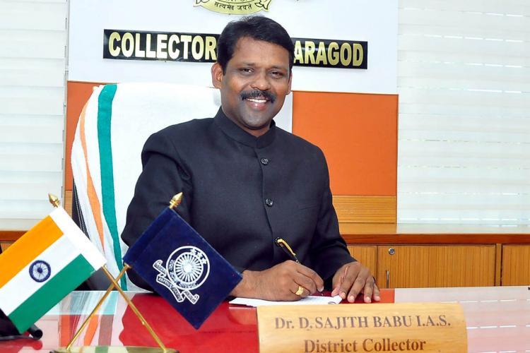 Kasaragod District Collector D Sajith Babu sitting at his desk